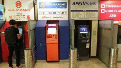 "Photo of إزالة القيود الخاصة بساعات عمل الصرافات الآلية ""ATMs"" بماليزيا"