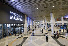 """Photo of ماليزيا تضع شروطاً لإعادة فتح حدودها أمام الدول """"الخضراء"""""""