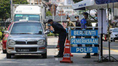 صورة دعوات للحكومة الماليزية بتمديد جديد لتقييد الحركة